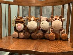 assortment of cow,giraffe,horse, and tiger stuffed animals f