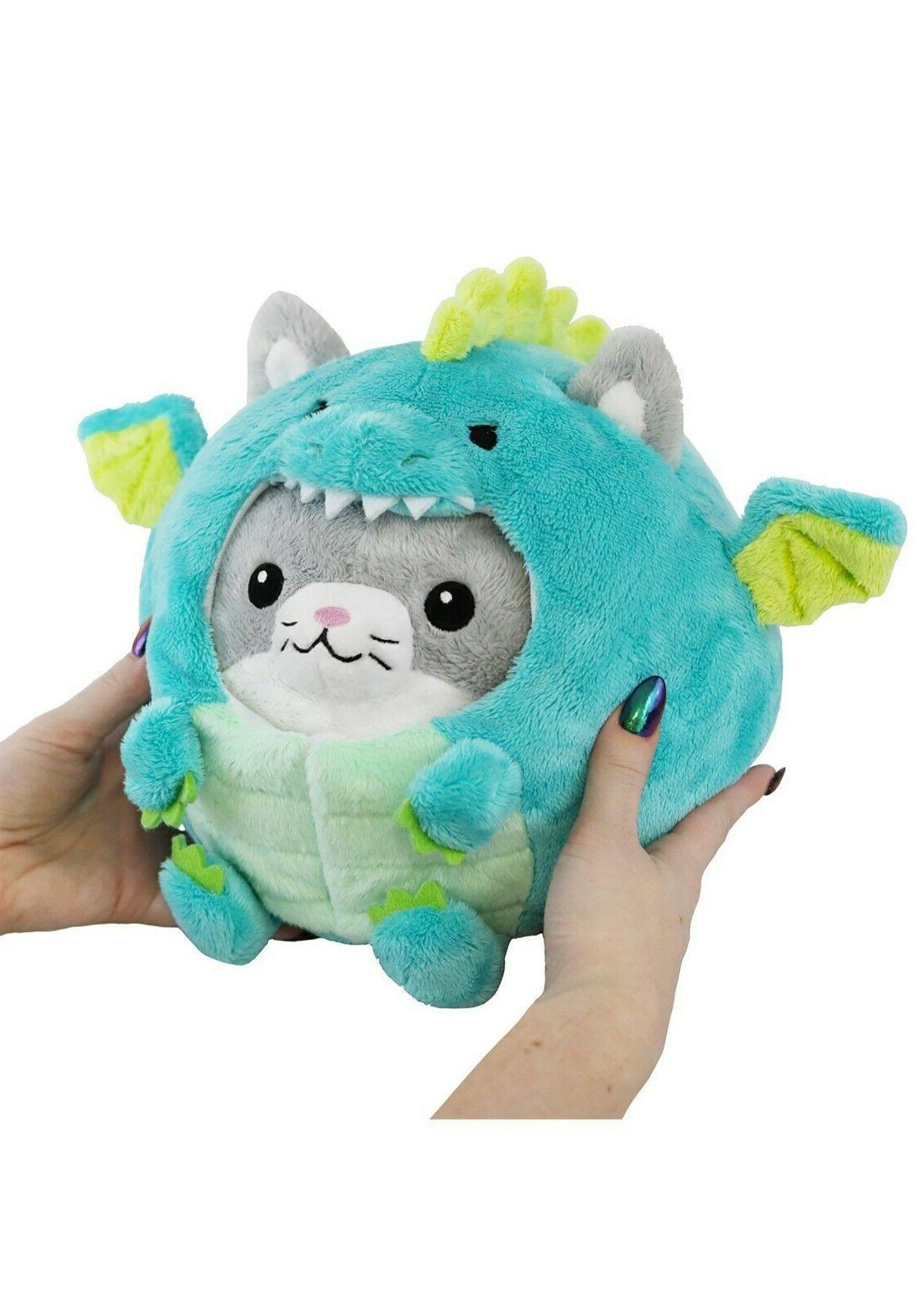 undercover stuffed animal kitty in dragon costume